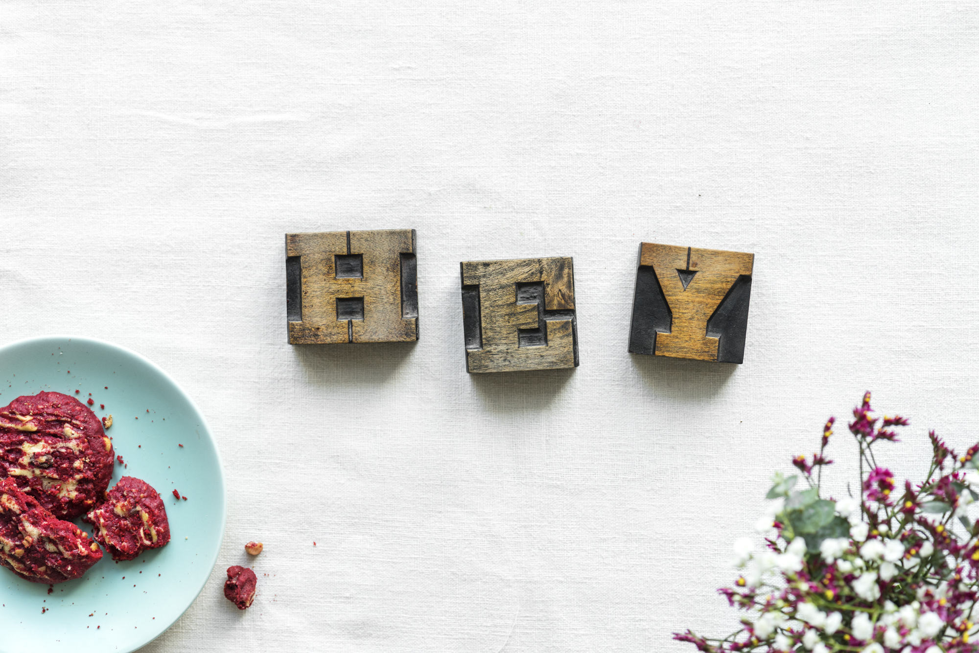 Antique grunge letter cube spelling hey greeting